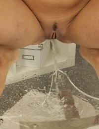 Babe Cynthia is pissing in her jeans short pretty sexy in close-up