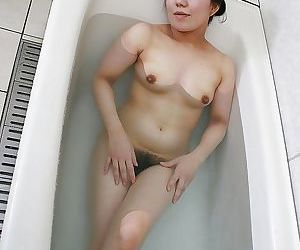 Fuckable asian mature lassie taking bath and exposing her goods
