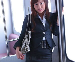 Gorgeous Japanese girl Mami Asakura opens her shirt to expose her small boobs