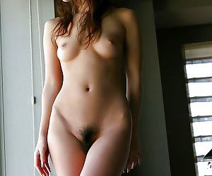 Well-graced asian girl with bushy cunt demonstrates her tempting curves
