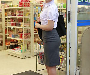 Beautiful Japanese woman Ai Yoneyama posing in public in tight pencil skirt