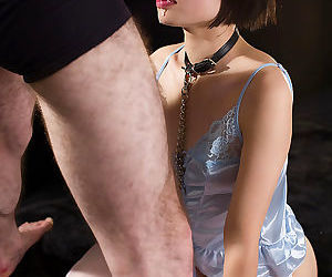 Japanese sex slave is forced to suck cock in satin lingerie and nylons