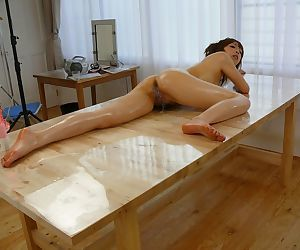 Japanese Hana Haruno oiled before man came to fuck her ass with toys on table