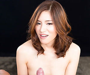Beautiful Asian girl on her knees giving hot handjob with small tits showing