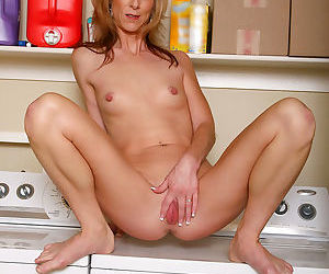 Attractive mature cougar shows off her elongated nipples in the laundry room - part 6