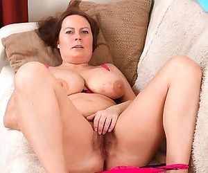 A busty alexis may strips nude on her sofa - part 8