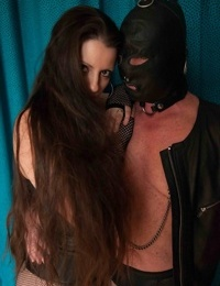 Femdom in sexy boots and fishnet Larissa Gold tortures her slaves testicles