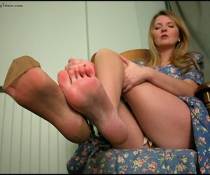 Mature woman Tasty Trixie takes off sexy nylons after hitching up her dress