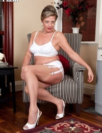 Hot mature Silky bares her saggy boobs & poses in vintage garter & stockings