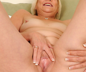 Mature model Sindy Silver gets totally naked on loveseat during solo action