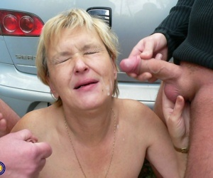 Nasty slut Sigrid gets facialed by two horny young men in the woods