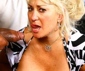 Seductive MILF Dana Hayes rides a big black cock after blowing him