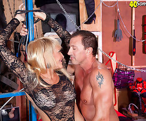 Mature woman Brittney Snow has her big tits fondled during bondage play