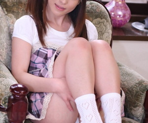 Japanese girl Arisa Suzuki lifts her dress to expose her underwear in socks