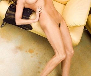 Hot brunette Ava Fabian strips her corset off and shows long legs and big tits