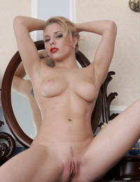 Gorgeous blonde Sabrina slips off lingerie pairing for great nude poses
