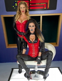Leather and latex attired lesbians go tongue to tongue after eating pussy