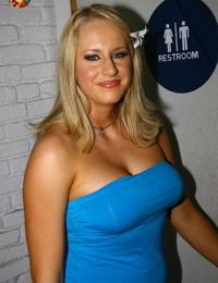 Tall blonde Cassady Blue sucks off a BBC via a gloryhole in bathroom wall