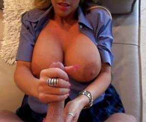 Mature knockout gives a handjob and milks a boner on her face and big tits