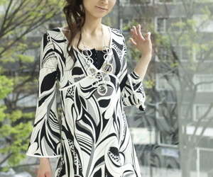 Fully clothed Japanese teen Yuka Yamada shows long legs in dress and heels