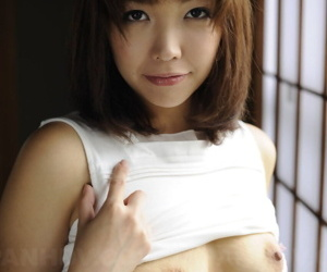 Japanese solo girl Juri Kitahara tentatively shows her trimmed pussy