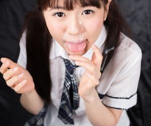 Japanese schoolgirl Araki Mai sucks the cum from a cock in her school uniform