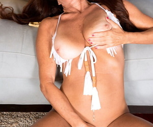 Mature woman Layla Lamora frees her big hangers from bikini as she gets naked