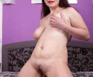 30 plus lady with red lips and a hairy pussy works clear of crotchless hosiery