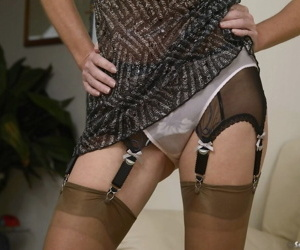 Mature lady Satin Jayde adjust her garter belt and slips off white underwear