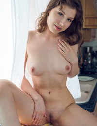 Girl next door type Satin Stone gets completely undressed in the kitchen