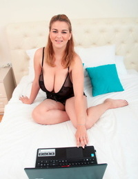 Big boobed girl Erin Star bites down on a nipple while watching HD porn