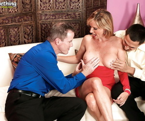 Mature reality sex with a stunning blonde being penetrated by two cocks