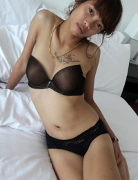 Petite Asian babe Mai gets naked on bed and plays with her small tits
