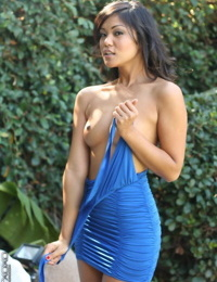Asian amateur Cat Xoxo frees her A-cup tits from a clingy dress outdoors