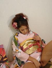 Japanese teen Iori Miduki slides upskirt panties aside in order to masturbate