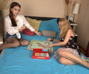 Older and younger lesbians play a board game before satisfying horny pussies
