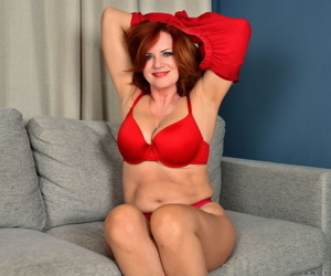 Older redhead Andi James showcases her trimmed snatch once she is naked