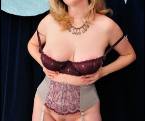 Mature MILF Tasty Trixie shows her big tits and ass in sheer nylons