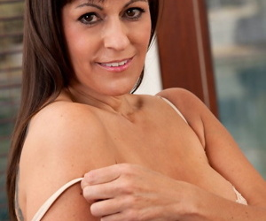 Busty brunette lady over 40 Tori Dean strips and takes a young boys virginity
