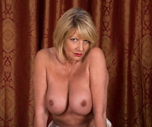 Older amateur Amy Goodhead shows off her big tits and pierced twat in nylons