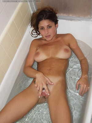 Busty amateur Ashton takes a bath and a shower after parting her pussy lips
