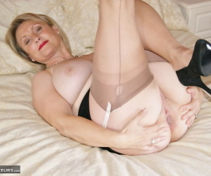 Mature wife fingers her pussy in nylons and skirt before sucking a big cock