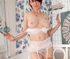 Older redhead Scarlet Rose exposes her wet cunt while doffing role play attire