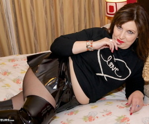 Overweight mature woman Dirty Doctor uncups her tits in a skirt and pantyhose