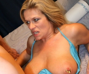Mature blonde lady with pierced nipples and pussy gets gangbanged