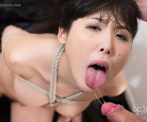 Japanese girl endures being mouth fucked while tied up with rope