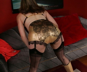 Mature woman removes red dress to model in gold lingerie of a vintage era