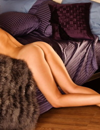 Astonishingly beautiful blonde Candice Hunnicutt posing nude on the bed