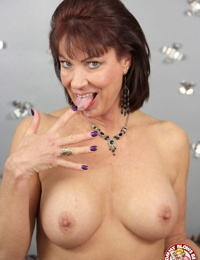 Busty mature woman Vanessa Videl sucks the jizz from a penis on her knees