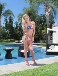 Blonde solo model Staci Carr strips off USA themed bikini beside pool